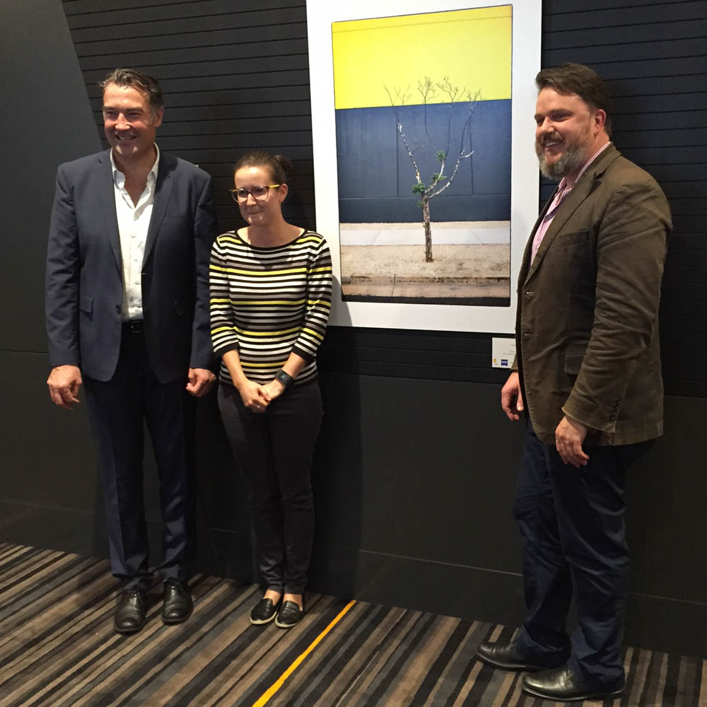 The winner Renate and her print, with James Muecke and Paul Atkins.jpg