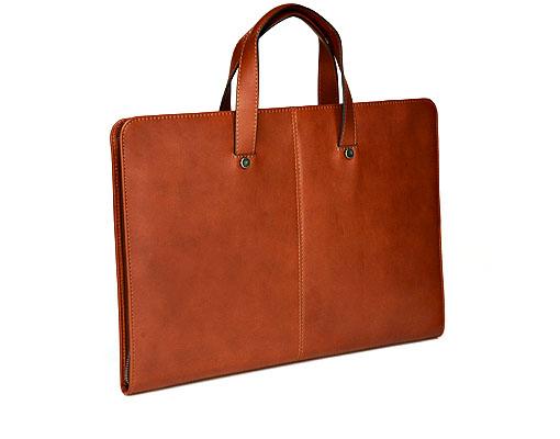 Cognac slim document carrier bag 12309. Suit Supply. $349.