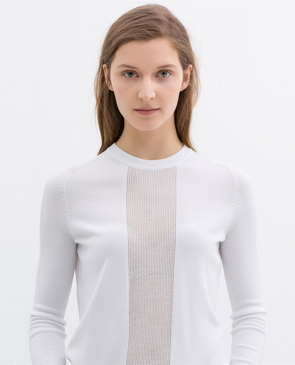Sweater with open work detail. Available in white or dusty pink. Zara. $49.90.