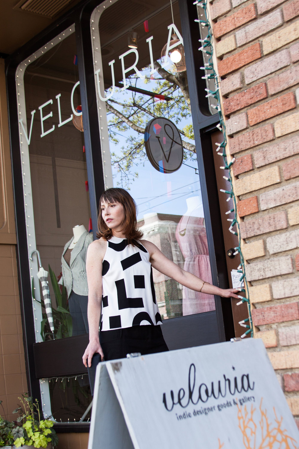 Amanda shows off a Dusen Dusen sleeveless top in front of the store on Market Street in Ballard. Photos by Selena Kearney.