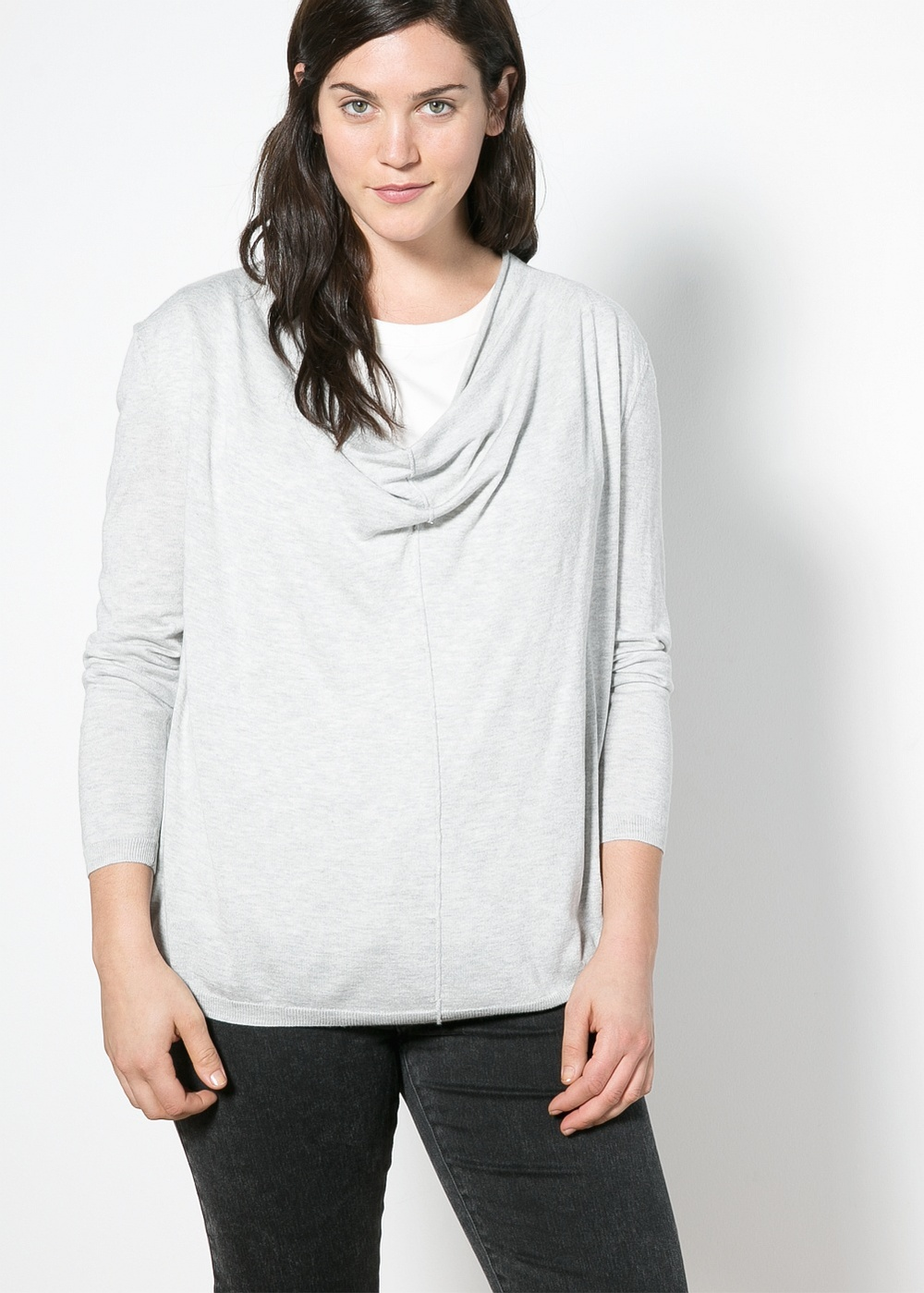 Simple neutral pieces are a perfect balance to more unique or daring pieces.  Draped neck sweater. Violeta by Mango. $59.99