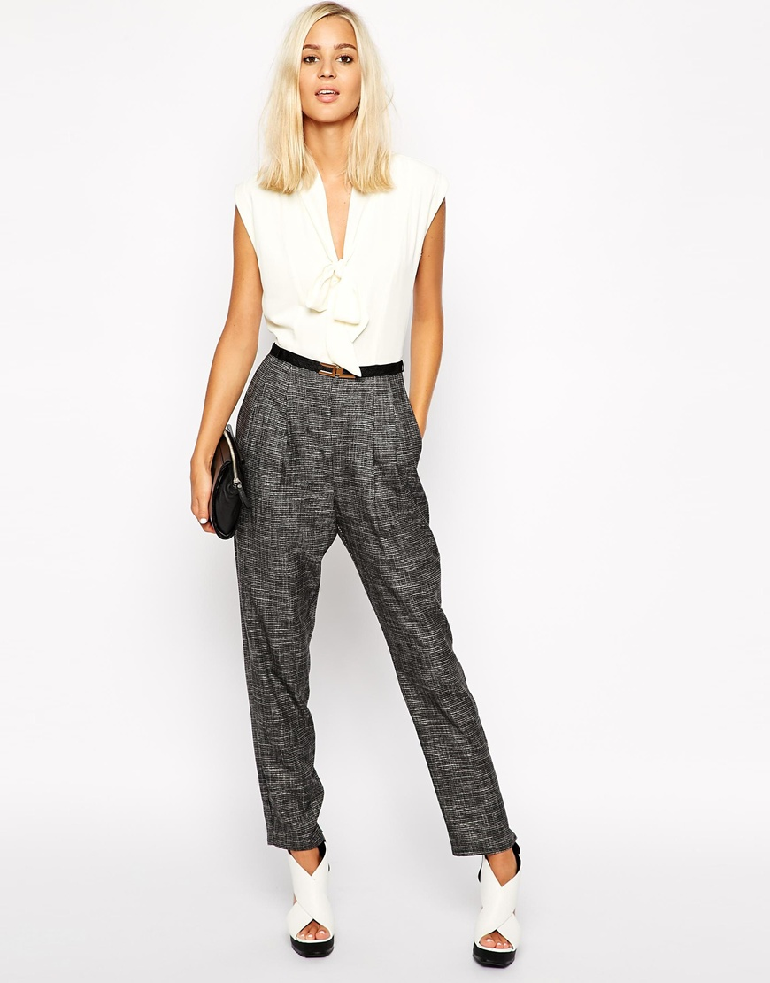 The complexity of two pieces with the ease of one. River Island Tie Neck Jumpsuit. ASOS. $91.41.