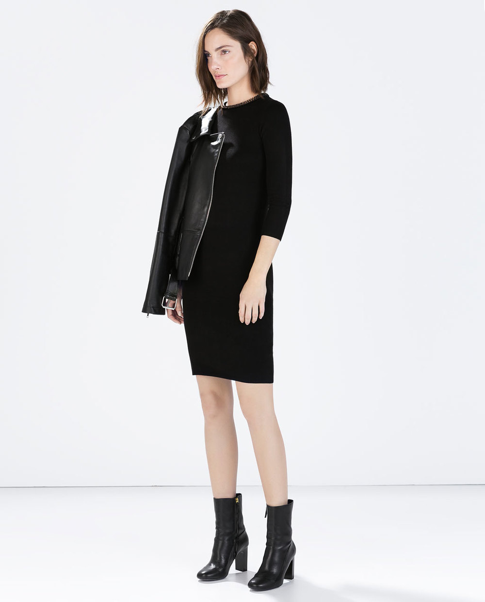 Dress with detail on the collar. Zara. $59.90.