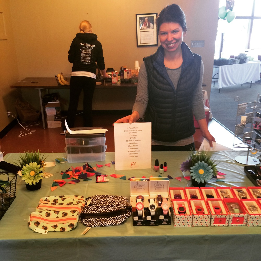 An F-Factor volunteer rocks the accessories table at the Fitness and Fashion workshop.