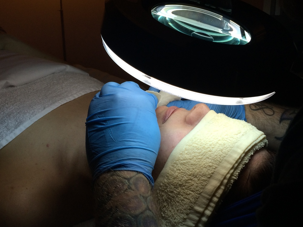 The assessment. There's nothing like a crazy spotlight to ensure the experts can see every pore.