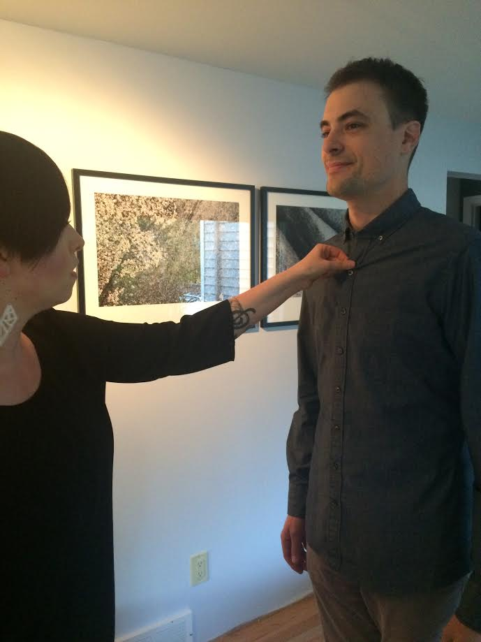 Here's my husband and Ashley Bachelder, our J. Hilburn Rep as she reviews the fit on his new shirt.