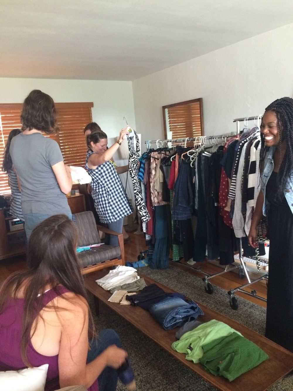 At my client, Kat'es swap, she rented racks and set up all the clothing in the living room. Refreshments were in the adjoining dining room and guests changed in one bedroom.