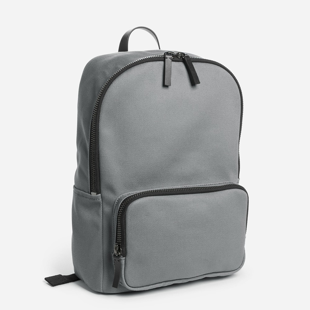 The Modern Zip Backpack Mini. Available in multiple color combinations. Everlane. $58. (Fits a 13 inch Macbook.)