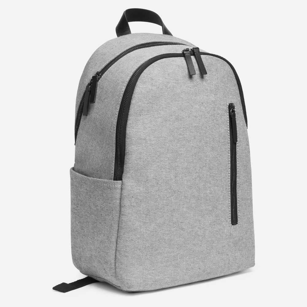 The Modern Commuter Backpack. Available in multiple color combinations. Everlane. $68. Padded laptop sleeve fits 15 inch Macbook.