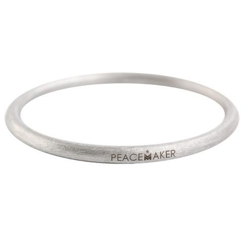 the Peacemaker bangle. Made from unexploded ordinance and war scrap (aka bombs) in Laos. Combat Flip Flops. $39.