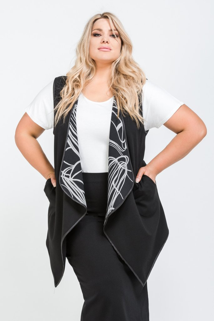 Changes Reversible Vest. Harlow. Was: $249. Now: $124.