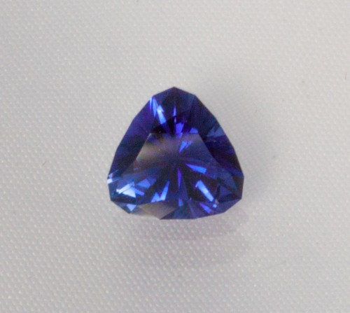 Step 2:  Faceting by a gem cutter: A Tanzanite trillion purchased rough from a Maasai warrior!