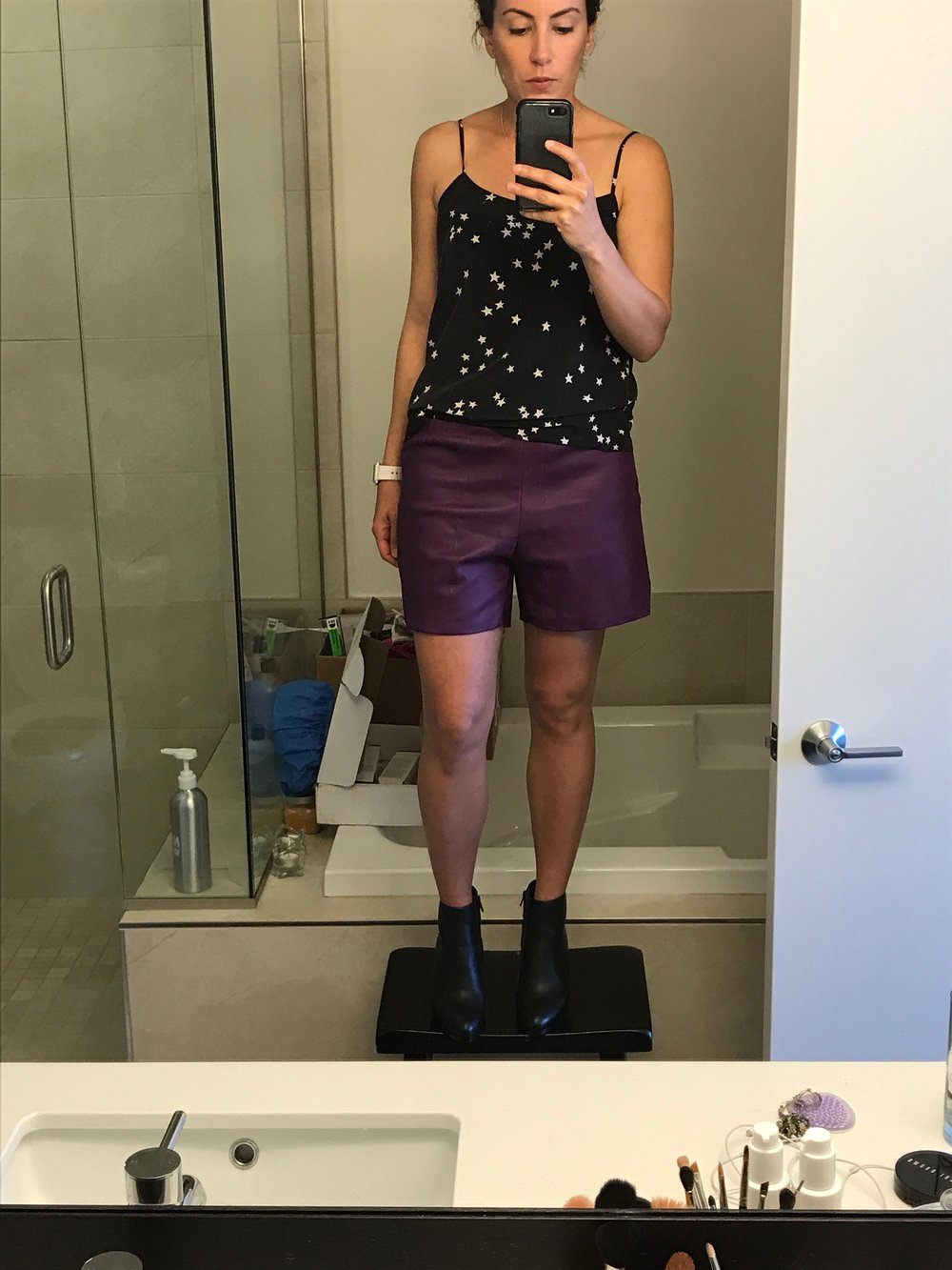 We decided she'd get lots of use out of a pair of leather shorts. So, the tailor transformed the skirt into this pair of shorts.