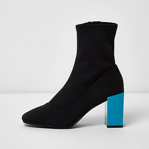 Black contrast blue block heel sock boots. River Island. $110.