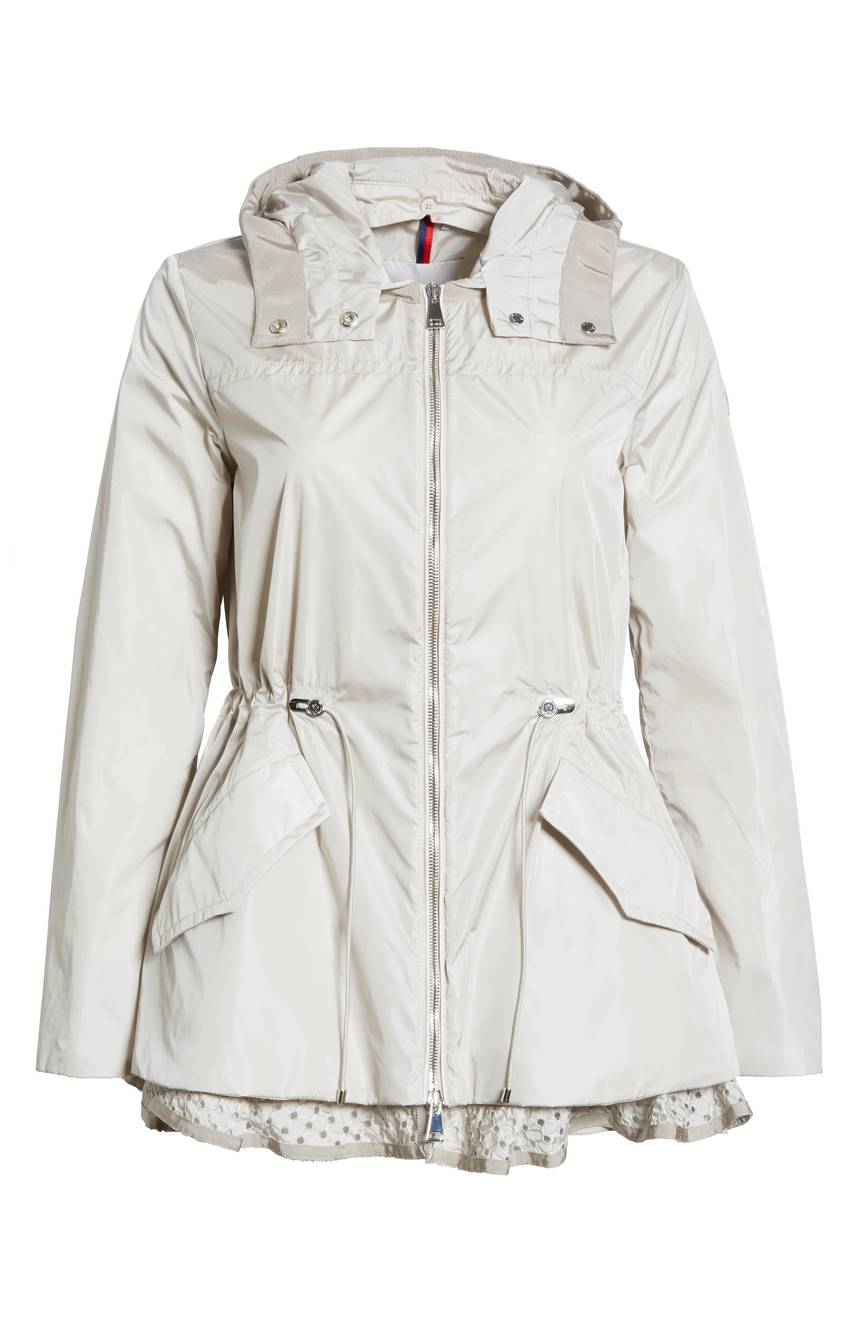 Moncler Lotus Water Resistant Peplum Raincoat. Available in navy, sand. Nordstrom. $950.