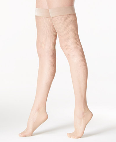 1. DKNY Fishnet Thigh Highs. Available in nude, black. Macy's. $18