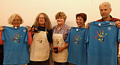 Smiley Faced Board members displaying new Frederic Arts Merchandise.  check it out!
