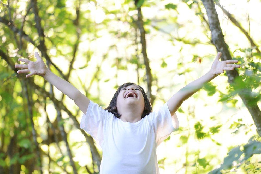 boy_yoga_forest_happy