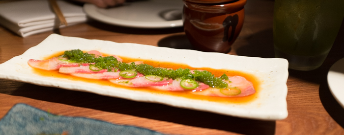 Yellowtail sashimi, lime soy, green chilli, granita