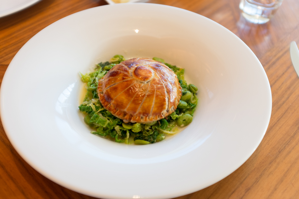 Baby leaf spinach, Somerset goats cheese and red onion pithivier, buttered savoy cabbage and turnip greens