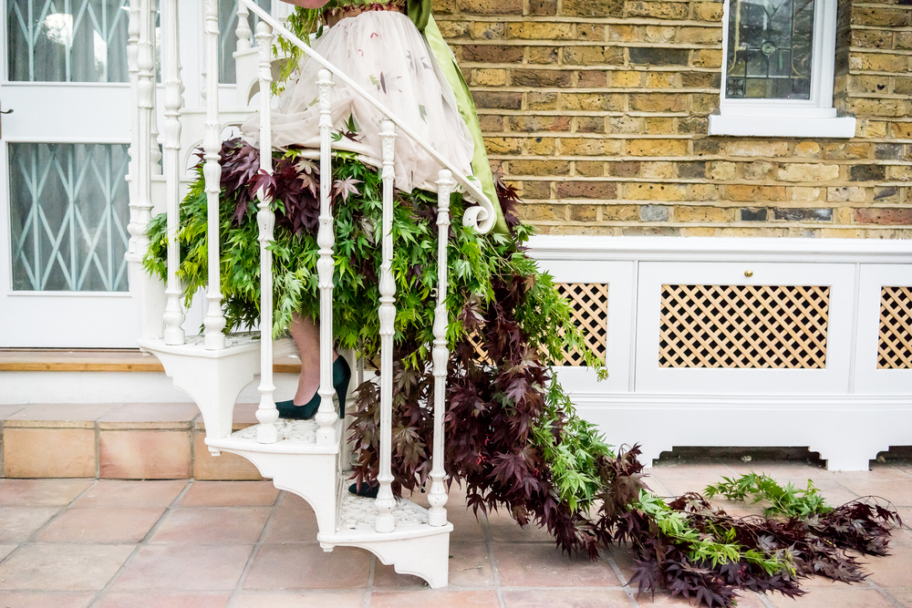 trailing acer dress on spiral staircase.jpg