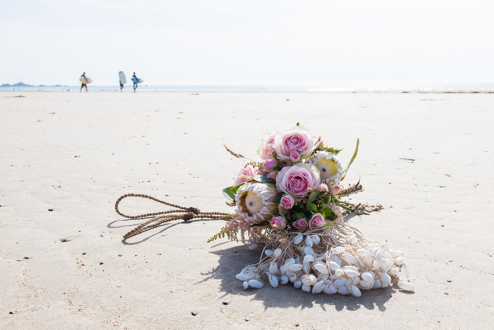 Bouquet at beach with protea and shells.jpg