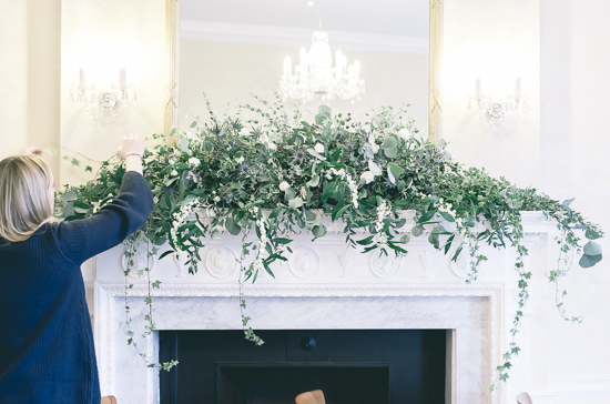 Jessie adding the final touches to the fireplace garland