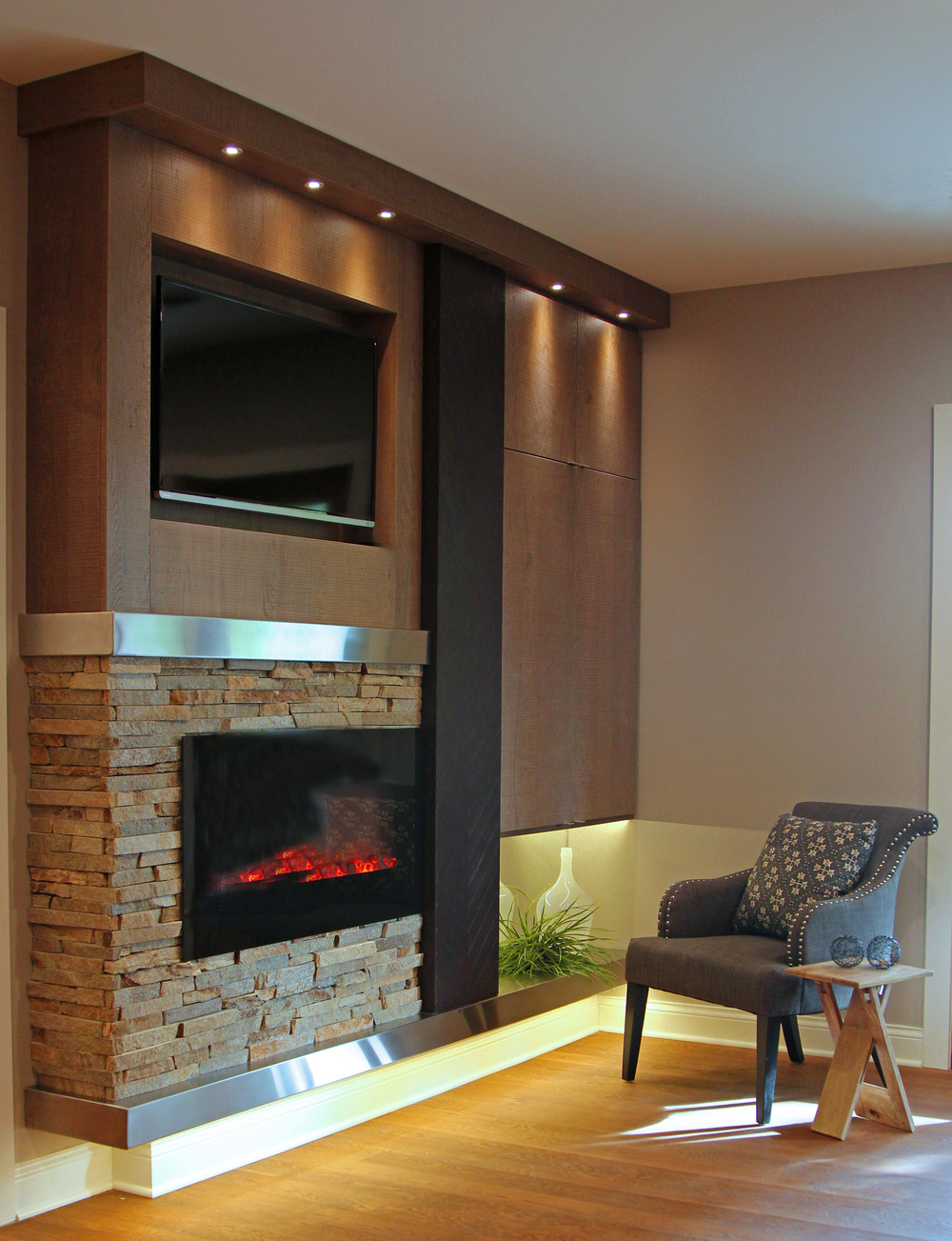 EcoDomo - Chevron Panel on fireplace wall.jpg