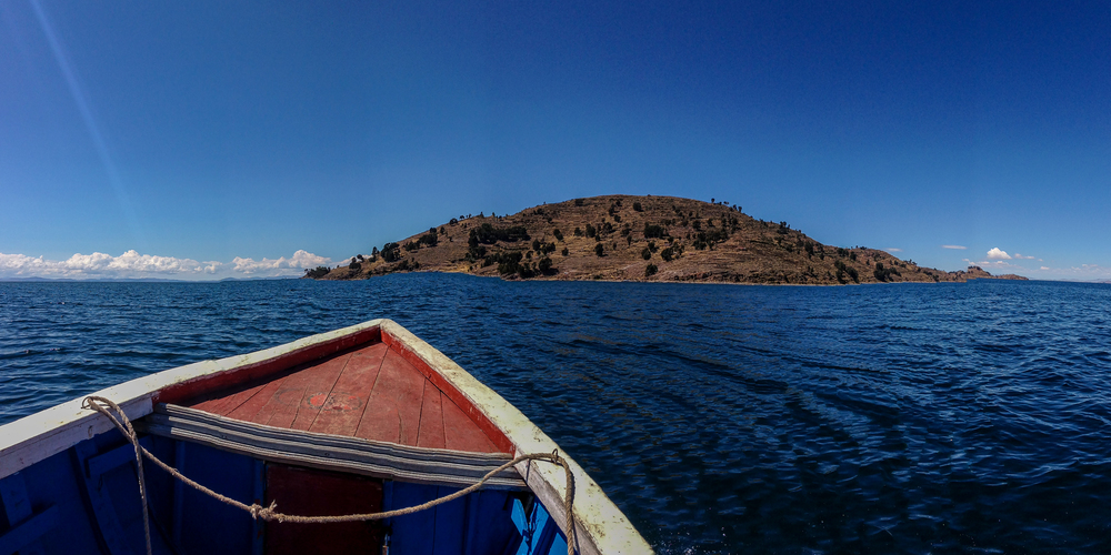 Taquile and the bow of Jose's boat. A panorama taken with my phone.