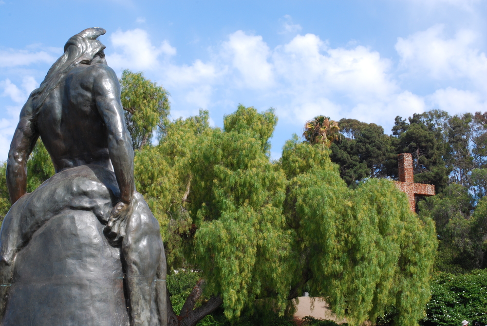 The Indian (1905), by Arthur Putnam juxtaposed with Padre Cross (1913), made of Presidio ruins.