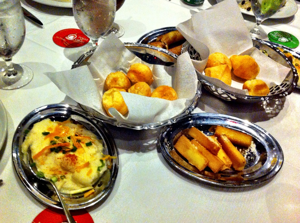 Fogo De Chão - (left to right) Mashed Potatoes, Pao De Queijo, Angu (Brazilian Polenta) and Caramelized Bananas