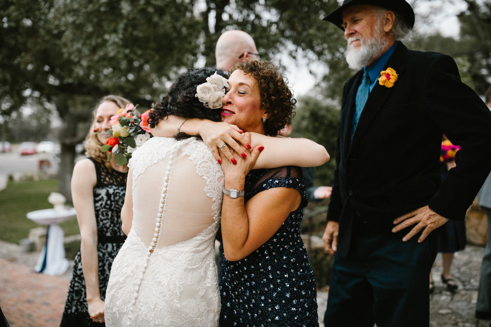 Mother of the bride hugging at Camp Lucy