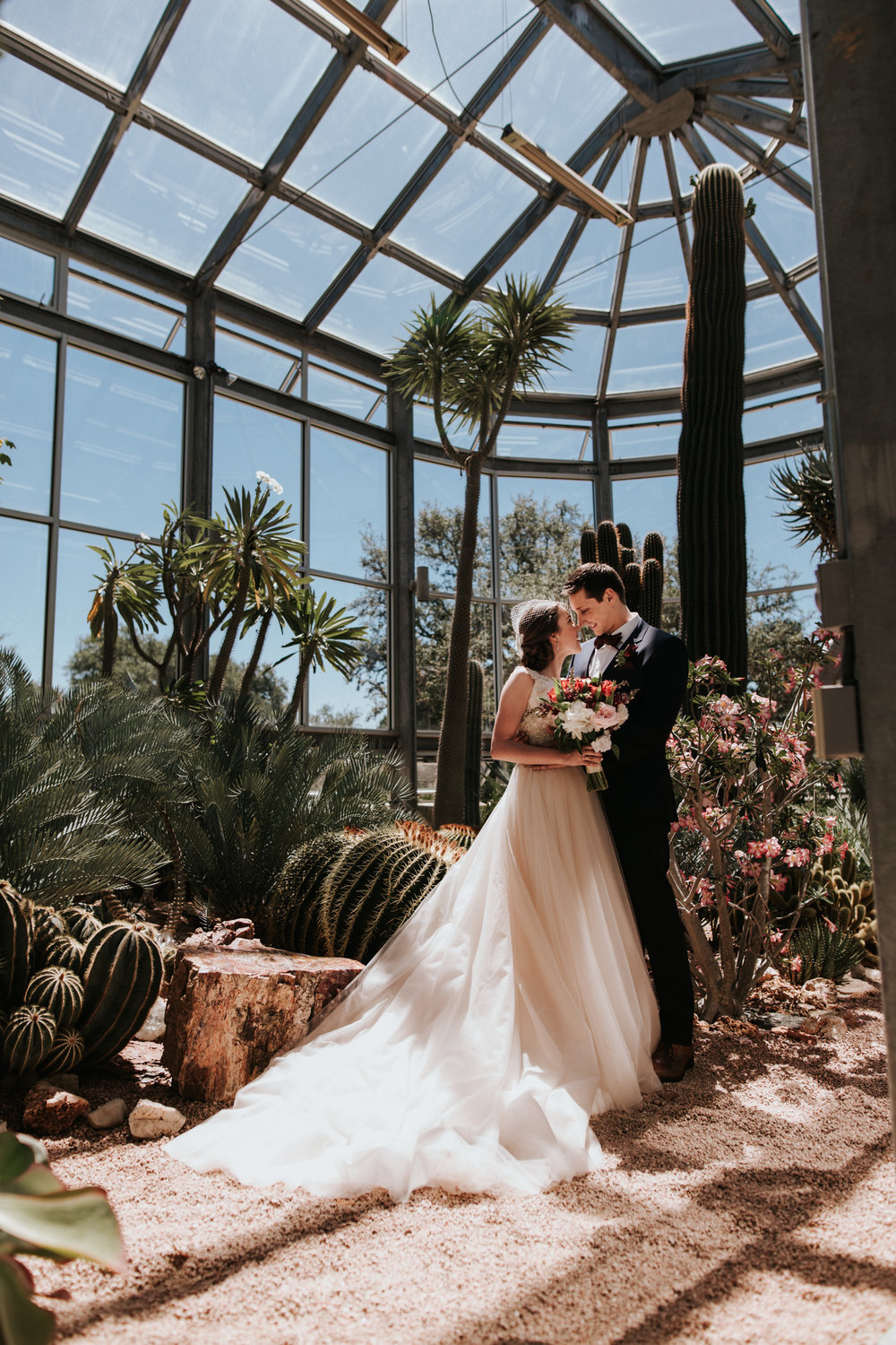 Bride and Groom inside a Greenhouse at Driftwood