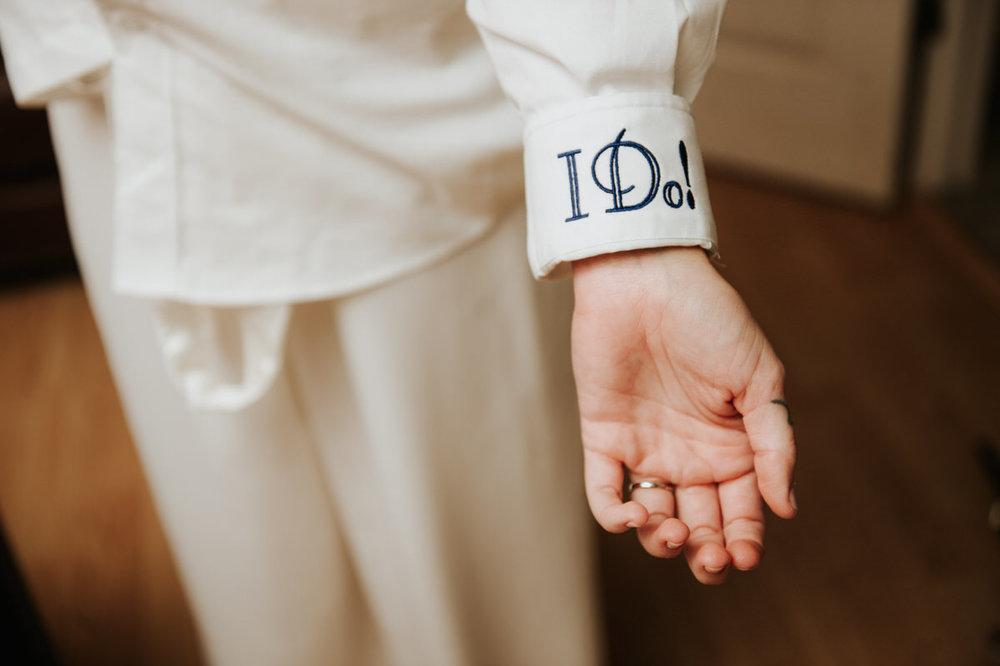 """I do"" bride's shirt cuff at Ranch Austin wedding"
