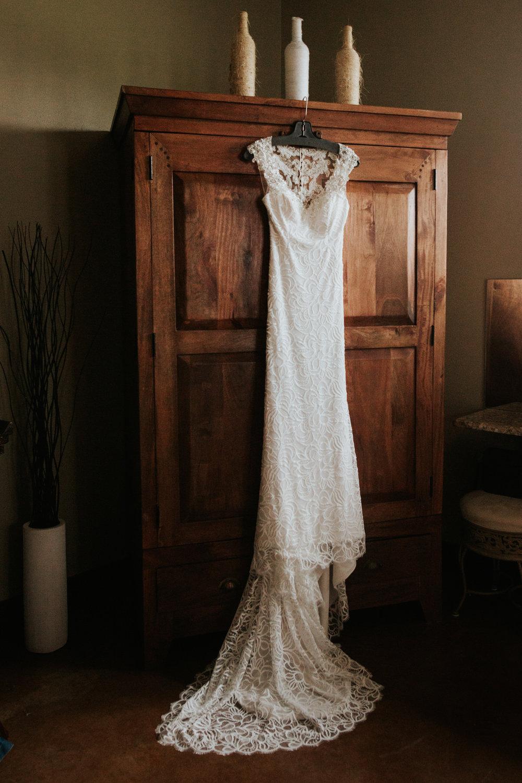Bride's dress hanging at Ranch Austin wedding