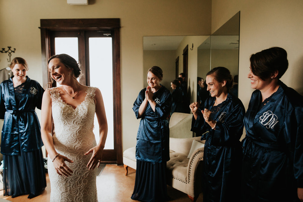 Bride and wedding party in monogrammed robes before wedding at Ranch Austin