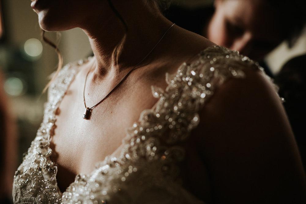 Close-up of bride's dress at Ranch Austin wedding