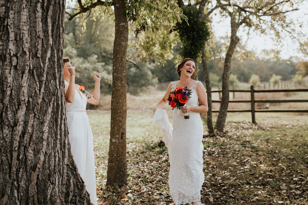 Happy same sex couple laughing before Ranch Austin wedding