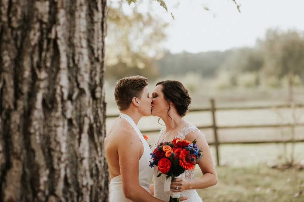 Happy same-sex couple kissing before Ranch Austin wedding