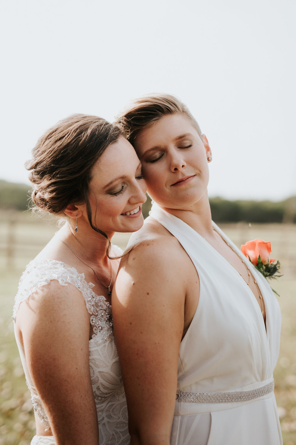 Two brides posing together at Ranch Austin wedding