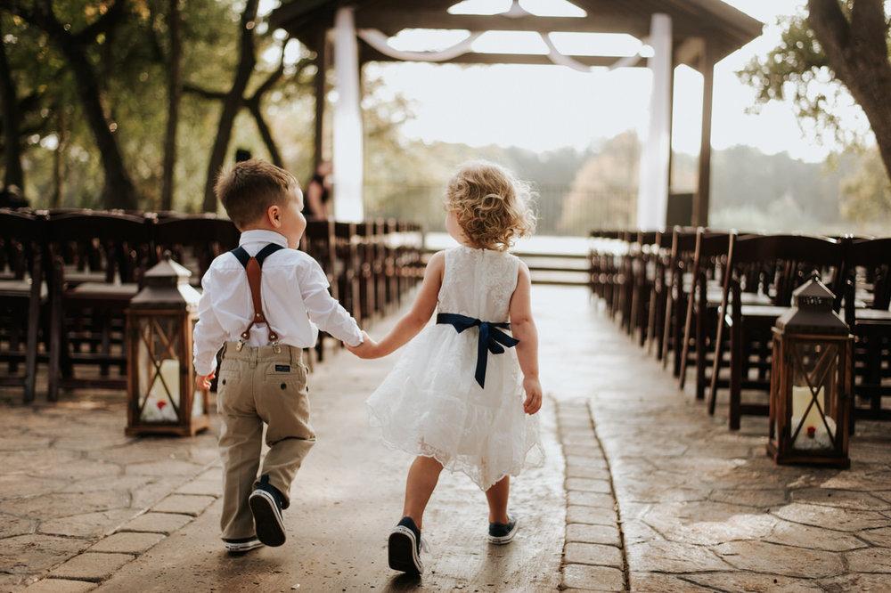 Cute little kids holding hands at Ranch Austin wedding