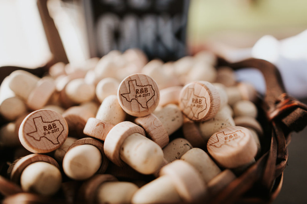 Corks with state of Texas on them as wedding favors at Ranch Austin wedding