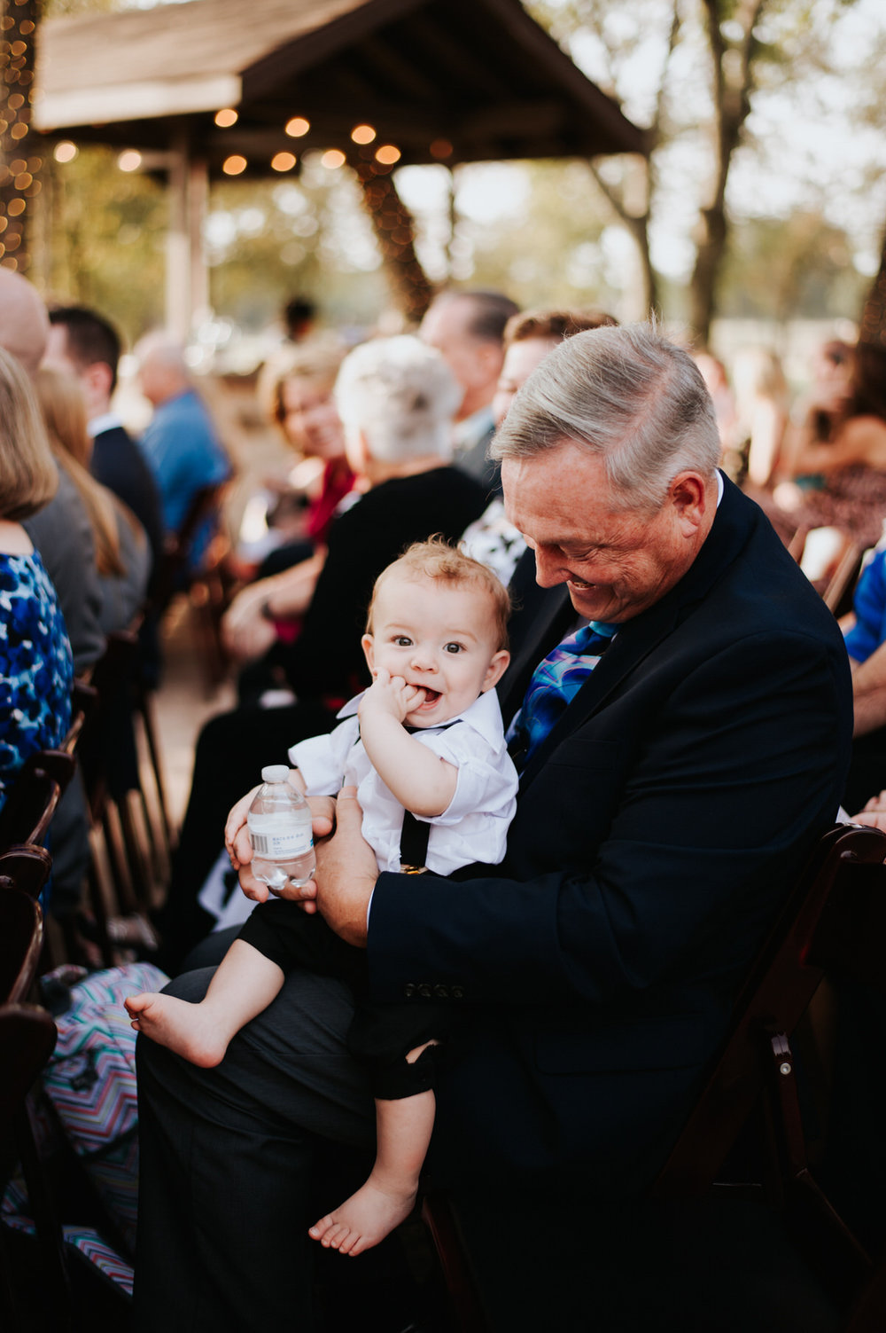 Grandpa and cute baby in wedding audience at Ranch Austin