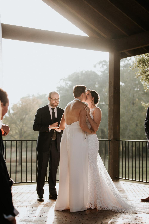Brides kissing at Ranch Austin wedding