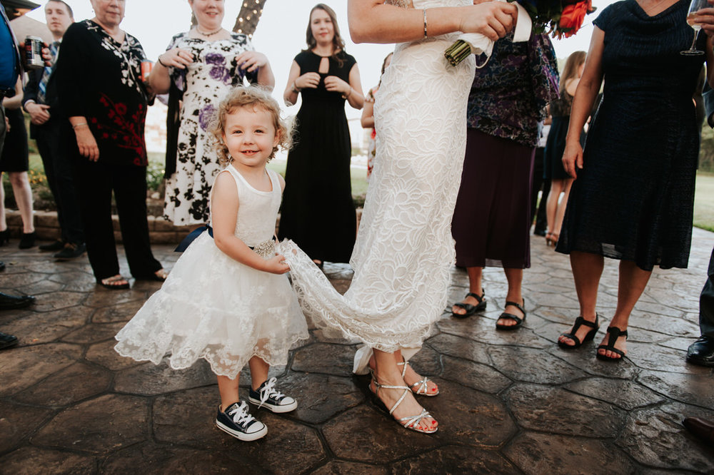 Bride with with cute little girl at Ranch Austin wedding