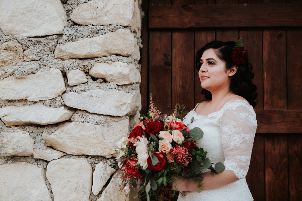Bride outside with flower bouquet
