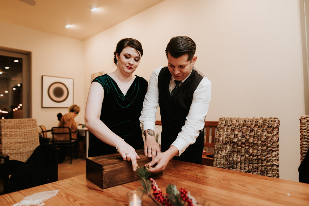 Bride and groom with wooden box