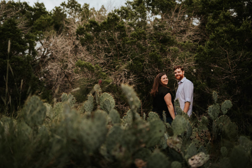 Engaged couple with cactuses
