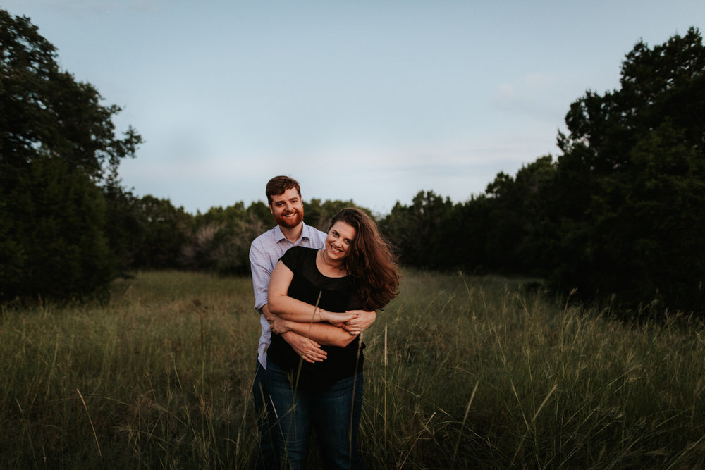 Happy couple getting engagement photos in Austin