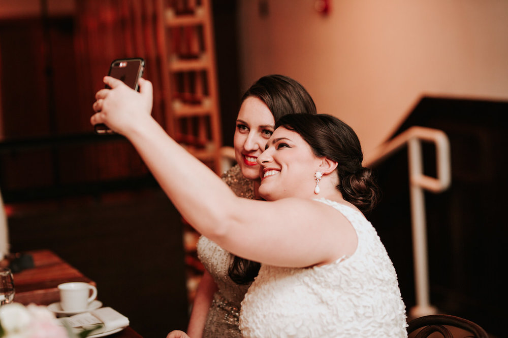 Two brides taking a selfie